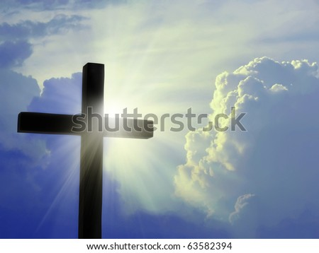 Cross silhouette against blue sky - stock photo