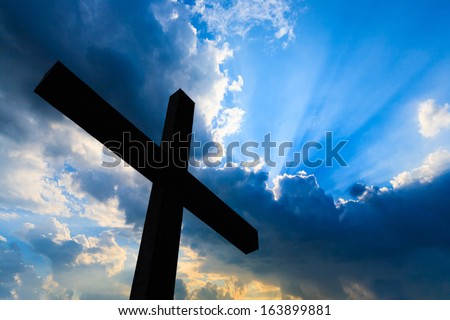 Cross silhouette and the holy blue sky - stock photo