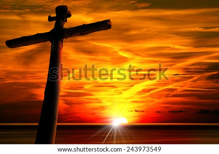 Cross Silhouette at the Sunset. Cross silhouette at the beautiful sunset over the sea with cloudy sky. - stock photo