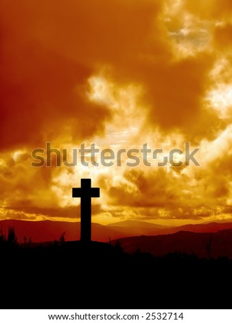 Cross  silhouette in high mountain against dramatical sky