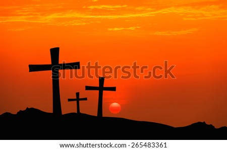 cross silhouette on mountain with sunset sky. - stock photo