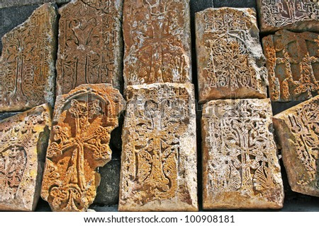 Cross-stones or khachkars at the 9th century Armenian monastery of Sevanavank. They are carved memorial stele, covered with rosettes and other patterns, unique art of Medieval Christian Armenia.