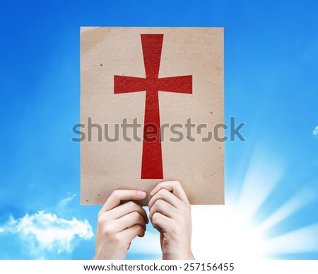 Cross Symbol card with sky background - stock photo