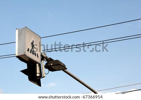 cross the street symbol with blue sky - stock photo