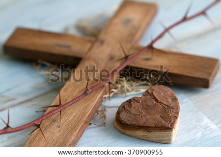 Cross thorn and wooden heart abstract easter concept