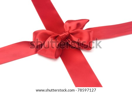Cross tied red ribbon bow on white background - stock photo