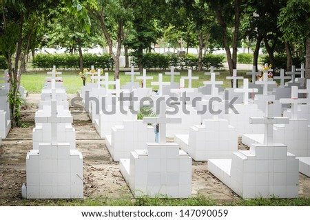 cross tombstones on a graveyard in the autumn