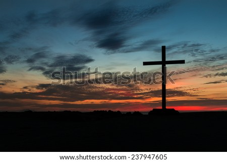 Cross with a wonderful colorful sunset. - stock photo