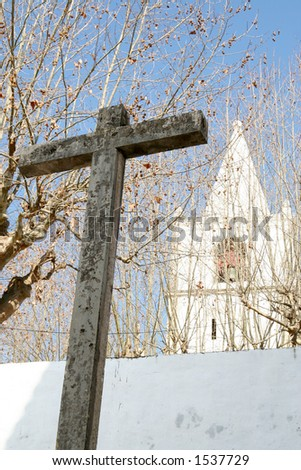 Cross with church in background - stock photo