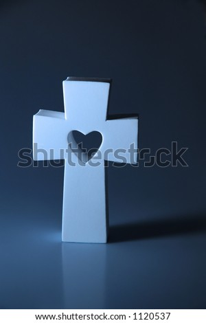 cross with heart on blue - stock photo
