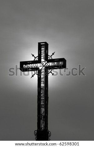 Cross with light passing through - stock photo