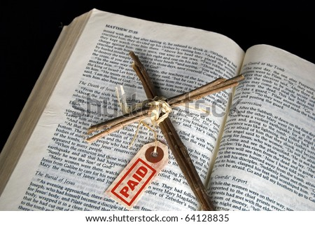 cross with paid tag on Holy bible - stock photo