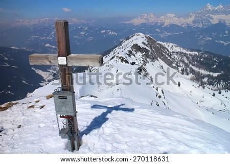 Cross with peak box on the summit  of Rippetegg, Austria - stock photo