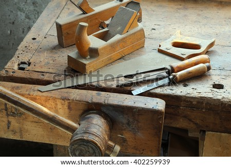 crosscut hand saw Planer and other tools of a carpenter for woodworking