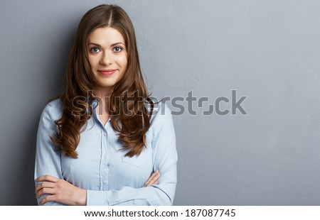 Crossed arms portrait of smiling business woman in studio. - stock photo