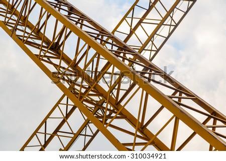 crossed beam crane - stock photo