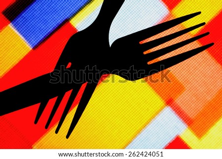 Crossed black plastic forks abstract design on colorful background.