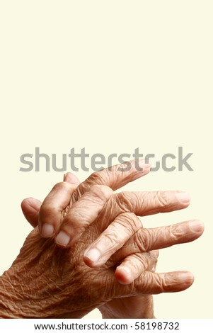 Crossed  fingers of an old asian woman - stock photo