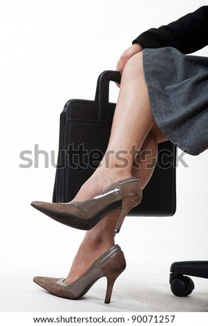 Crossed legs of a businesswoman