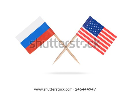 Crossed mini flags USA and Russia. Isolated on white background with shadow