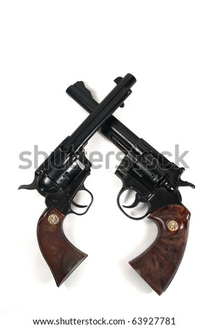 Crossed Revolver Guns on White Background - stock photo