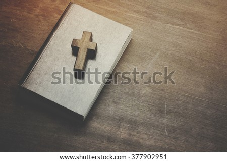 Crosses and books on a wooden table - stock photo