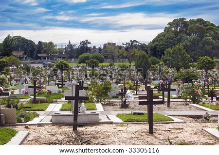 Crosses and tombstones at a cemetery - stock photo