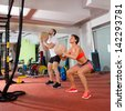 Crossfit ball fitness workout group woman and man at gym - stock photo