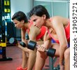 Crossfit fitness weight lifting Dumbbell woman at mirror workout exercise at gym - stock photo