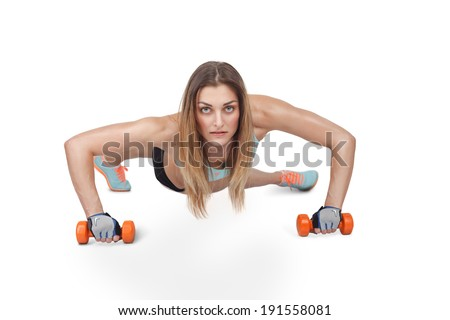 Crossfit fitness woman push ups Kettlebells pushup exercise at gym workout - stock photo