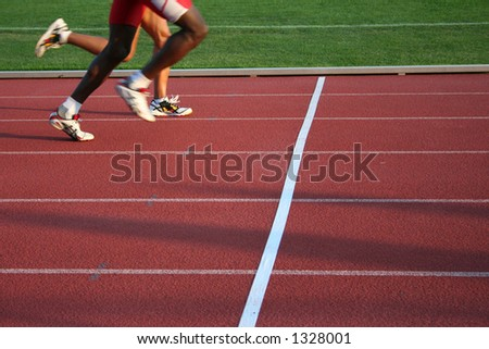 crossing finish line - stock photo