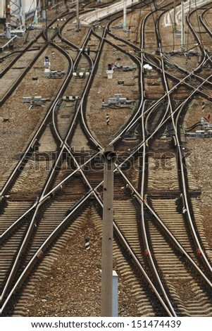 Crossing of a set of railroad tracks near the station - stock photo