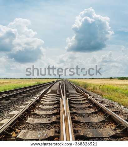 crossing of railways closeup under cloudy sky