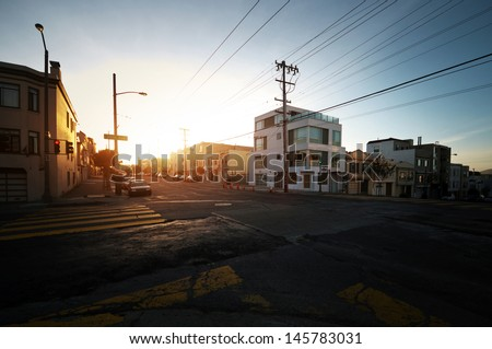 Crossing of two streets in San Francisco during sunset. - stock photo