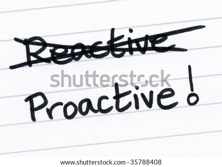 Crossing out reactive and writing proactive. - stock photo