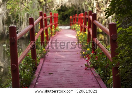 Crossing over the red bridge in Charleston, South Carolina - stock photo