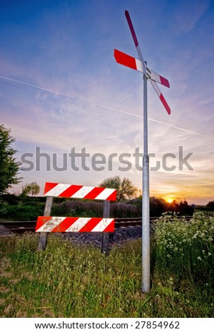 crossing railroad sign with a nice colorful sunset