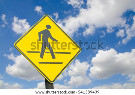Crossing Signs Traffic yellow board blue sky with cloud background copy space concept of road safety to reduce accidents.