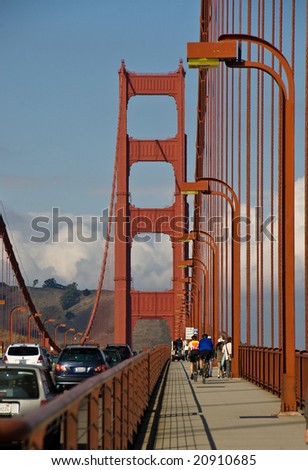 Crossing the Golden Gate Bridge by car, foot and bicycle - stock photo