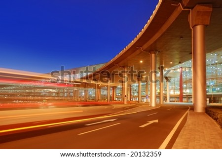 Crossing traffic highway to airport - stock photo