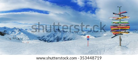 Crossroad sign in the Alps pointing to international cities, Ischgl, Austria. Panorama - stock photo