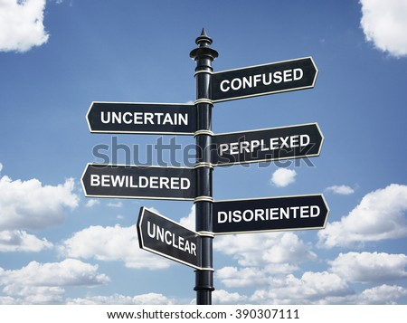 Crossroad signpost saying confused, uncertain, perplexed, bewildered, disoriented, unclear concept for lost, confusion or decisions - stock photo