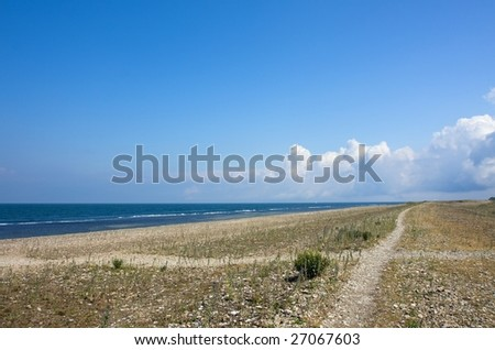 Crossroads at the coast - stock photo