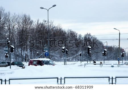 Crossroads with traffic lights in the winter