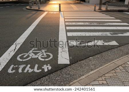 crosswalk and bike sign - stock photo