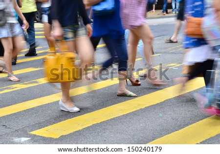 crosswalk and pedestrian at street in hong kong  - stock photo