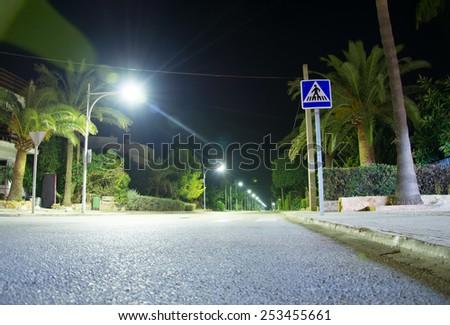 Crosswalk. Highway with lanterns at night. - stock photo