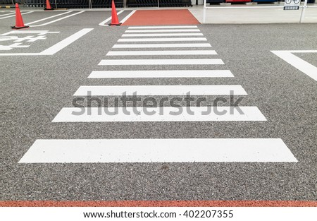 Crosswalk in the city beside  the store