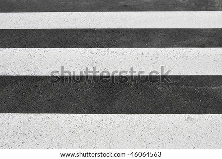 Crosswalk painted on the ground of a city - stock photo
