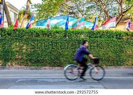 crosswalk with green background / Biking  - stock photo